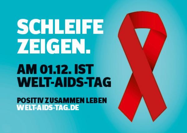 """Welt-Aids-Tag 2016, Rote Schleife auf grübem Grund. Aufschrift """"Schleife zeigen. am 01.12. ist Welt-Aids-Tag."""""""