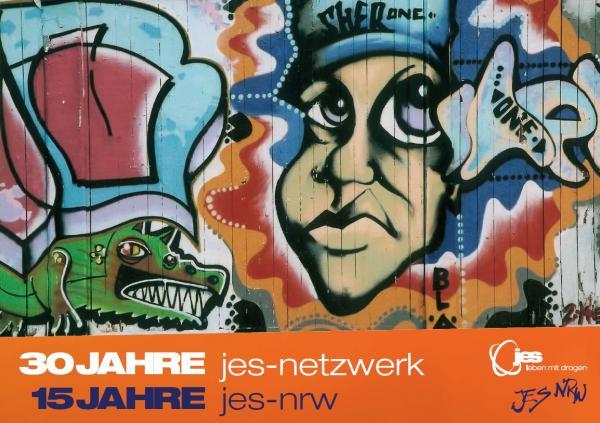 """Grafiti von einem Gesicht und einem Krokodil auf einer Hauswand. Titel """"30 Jahre JES-Netzwerk, 15 Jahre JES-NRW"""""""