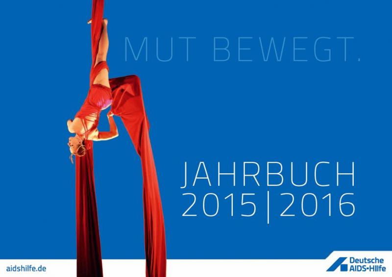 Titel Jahrbuch 2015/2016 Akrobatin in rotem Seil Hängend formt die rote Schleife.