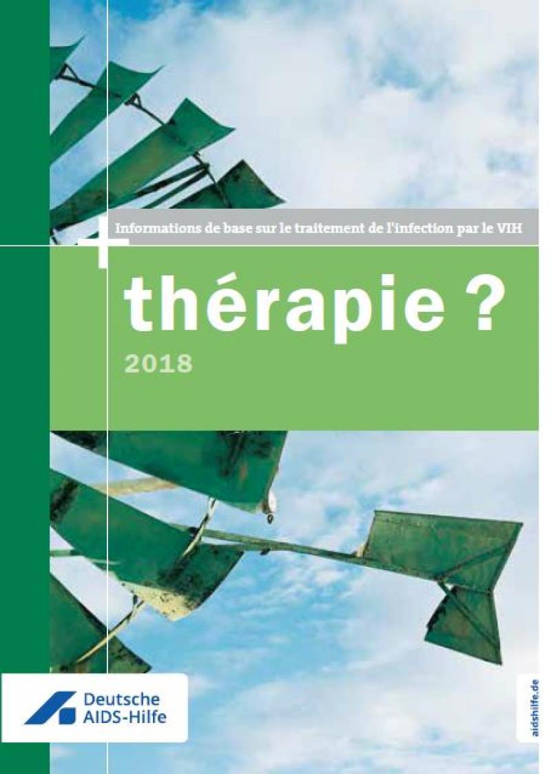 """Grünes Windrad vor leicht bewölktem Himmer. Titel """"therapie? 2018"""" in französischer Sprache"""